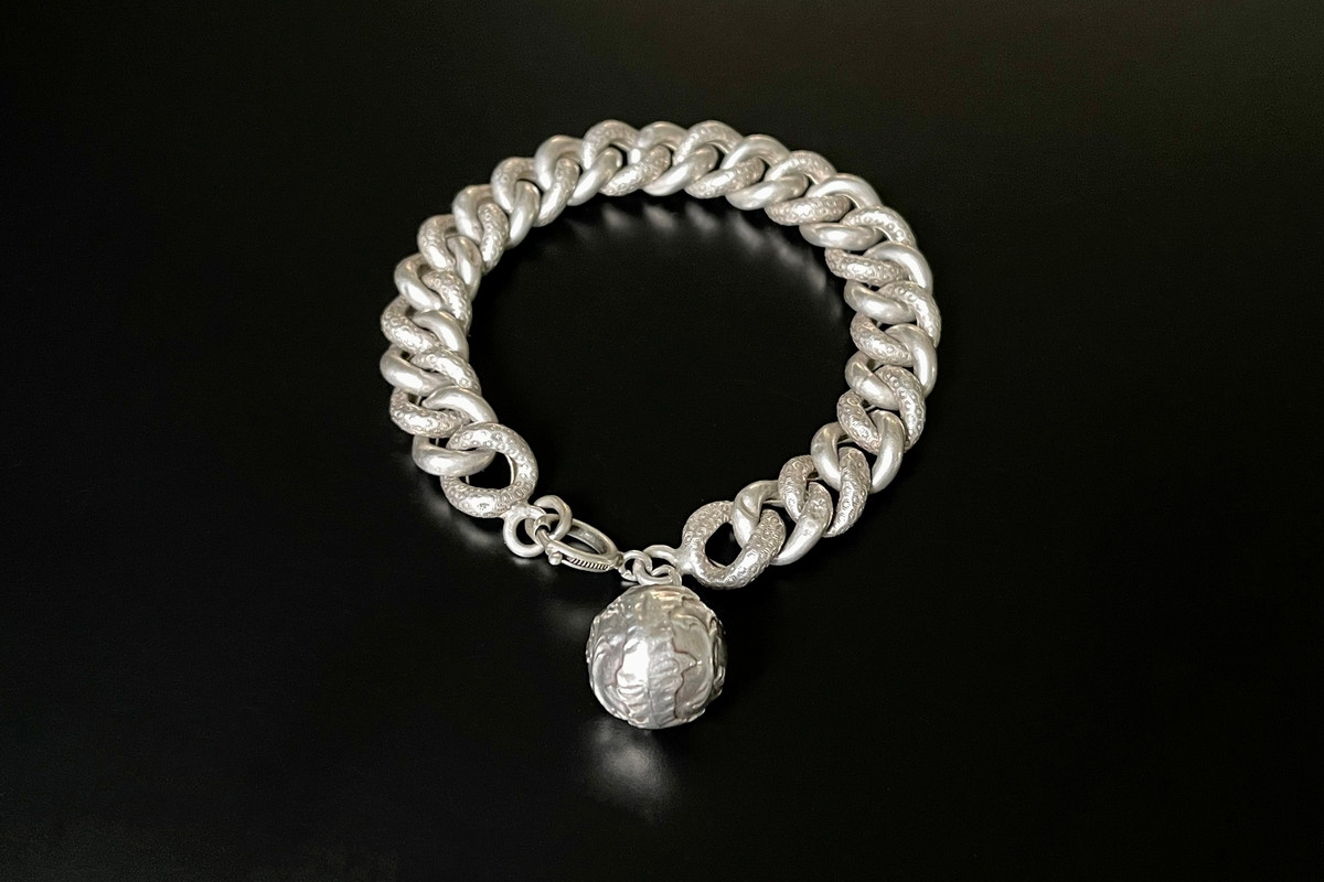 A Elegant French Silver Bracelet Curb link night and day design Finished with a chased ball Total weight: 19.15gms Total length: 205mm Antique Circa 1900