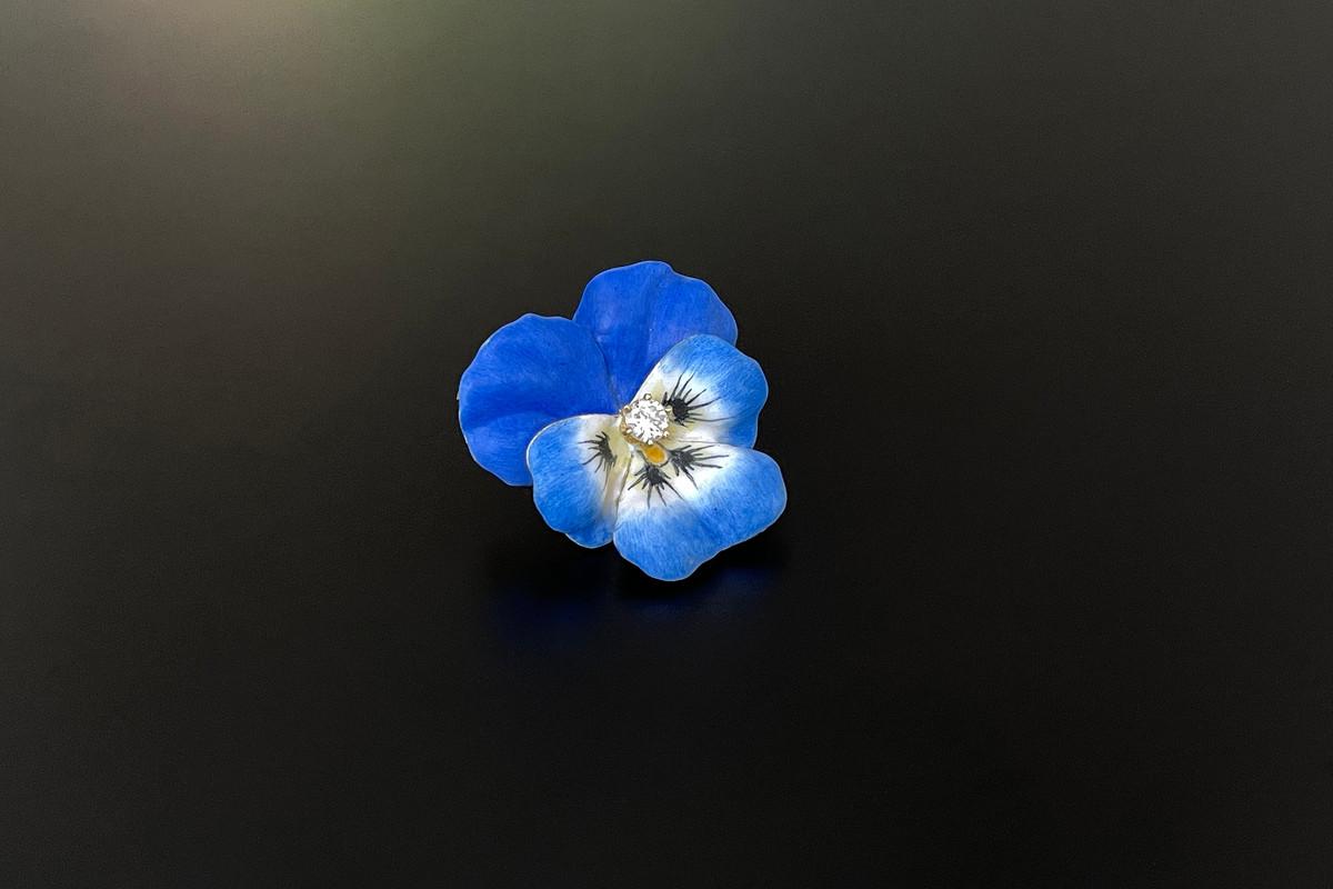 Blue enamel pansy with diamond