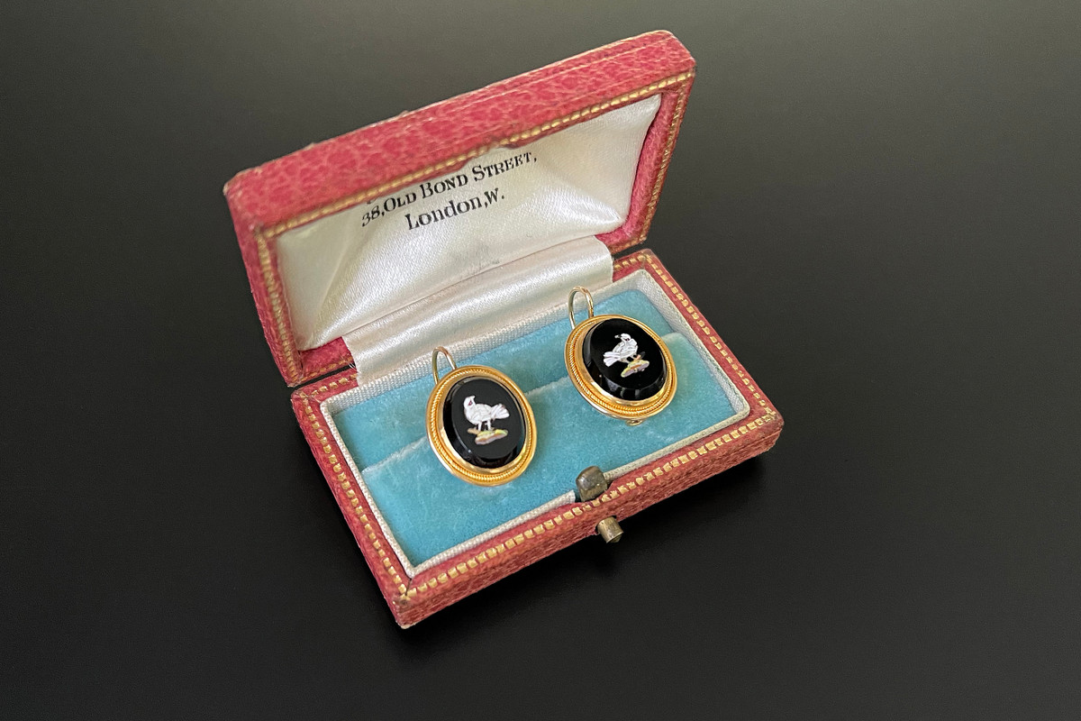 A Delicate Pair of Micro Mosiac Earrings Oval form depicting a dove. Black onyx finely inlaid with white, grey, green and brown mosaic tiles. Fluted gold frame with fine rope twist decoration. Shepherd hook fittings. 18ct yellow gold. Total weight: 3.85gms Victorian Circa 1870