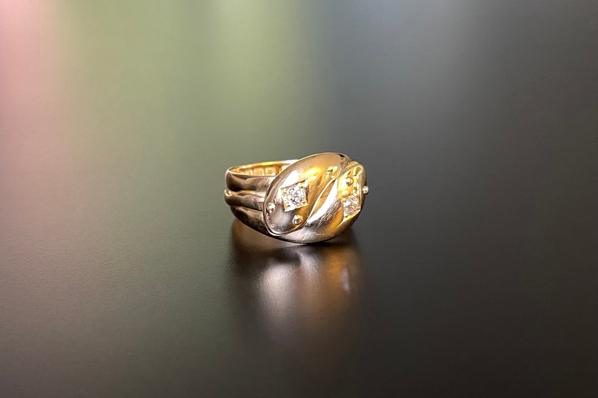 A Glorious Gold and Diamond Snake Ring Featuring two entwined snakes with an old European cut diamond set to the heads. 18ct yellow gold. Total diamond weight: 0.32cts Colour: I Clarity: SI Total weight: 9.35gms Hallmarked Birmingham 1901 Made by Coley Brothers