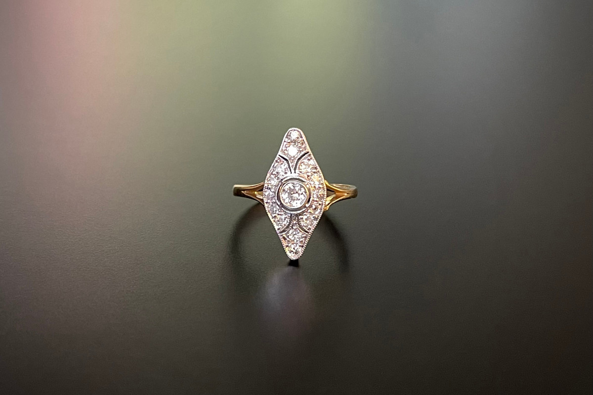 A Divine Diamond Plaque Ring Pierced navette form Principal old European cut diamond Openwork surround set with fourteen old cut diamonds. 18ct white and yellow gold. Total diamond weight: 0.48cts Colour: H-I Clarity: VS-SI Total weight: 4.87gms