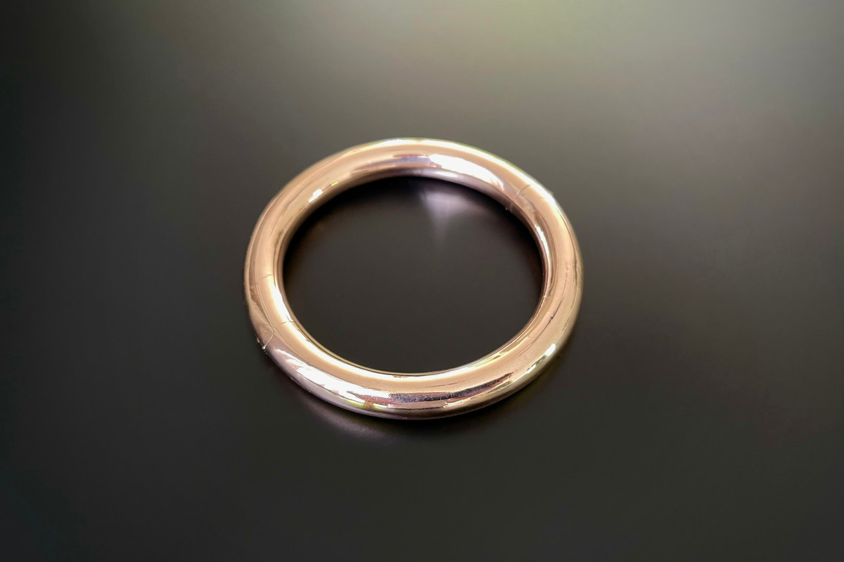 A Classic Gold Bangle by Willis & Sons Circular hinged form 9ct rose gold Total weight: 38.15gms
