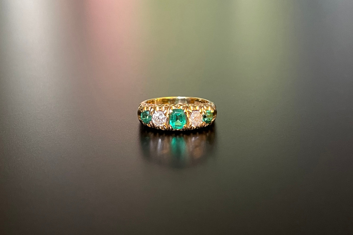 A Classic Emerald and Diamond Half Hoop Ring Featuring three emerald cut emeralds, interspaced with two old European cut diamonds 18ct yellow gold. Total emerald weight: 0.94cts Total diamond weight: 0.54cts Colour: J Clarity: SI