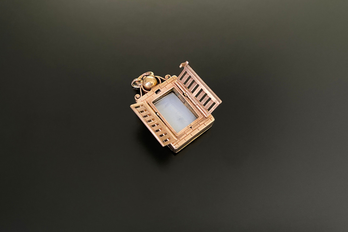 A Whimsical Gold Lined and Carnelian Pendant  Octagonal hinged form Having two shutters Carnelian panel to the reverse. 9ct rose gold lined. Antique