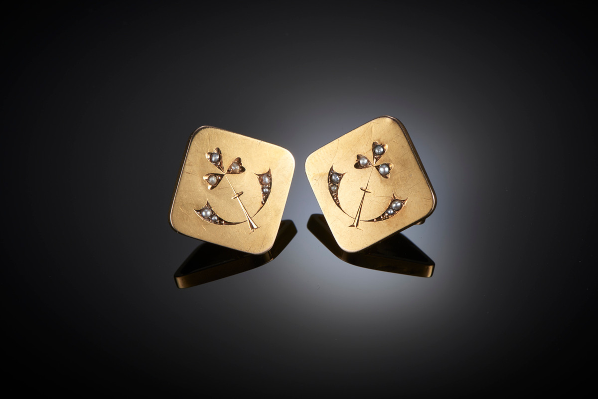 Gold Art Nouveau Cufflinks. In a square design with rounded edges, each set with seven seed pearls in stylised foliate form. 18ct yellow gold. French.