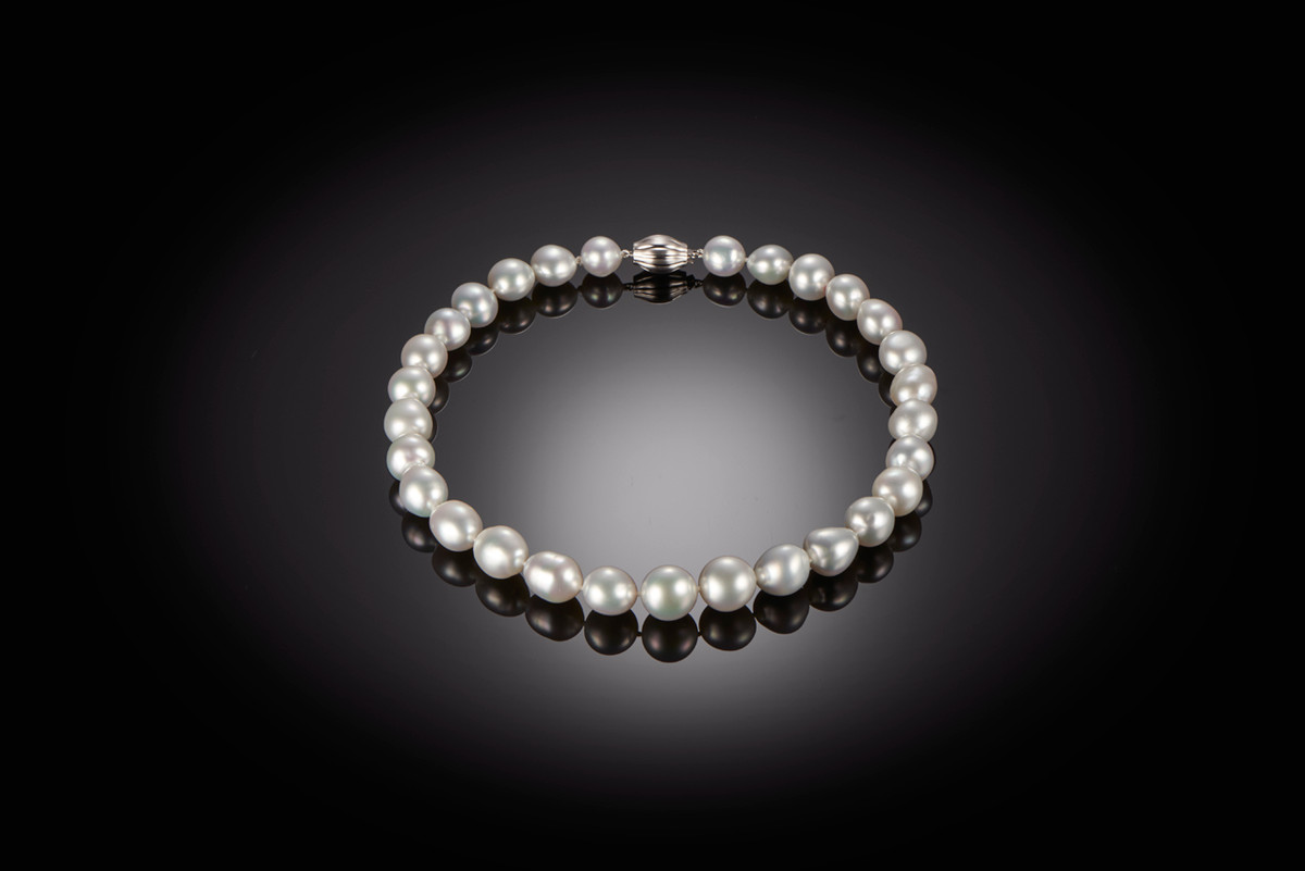 Baroque South Sea Pearl Necklace Twenty nine graduated baroque pearls of white and silver hues measuring 11.5mm - 15.0mm.  18ct white gold barrel clasp.  Total length: 455mm.