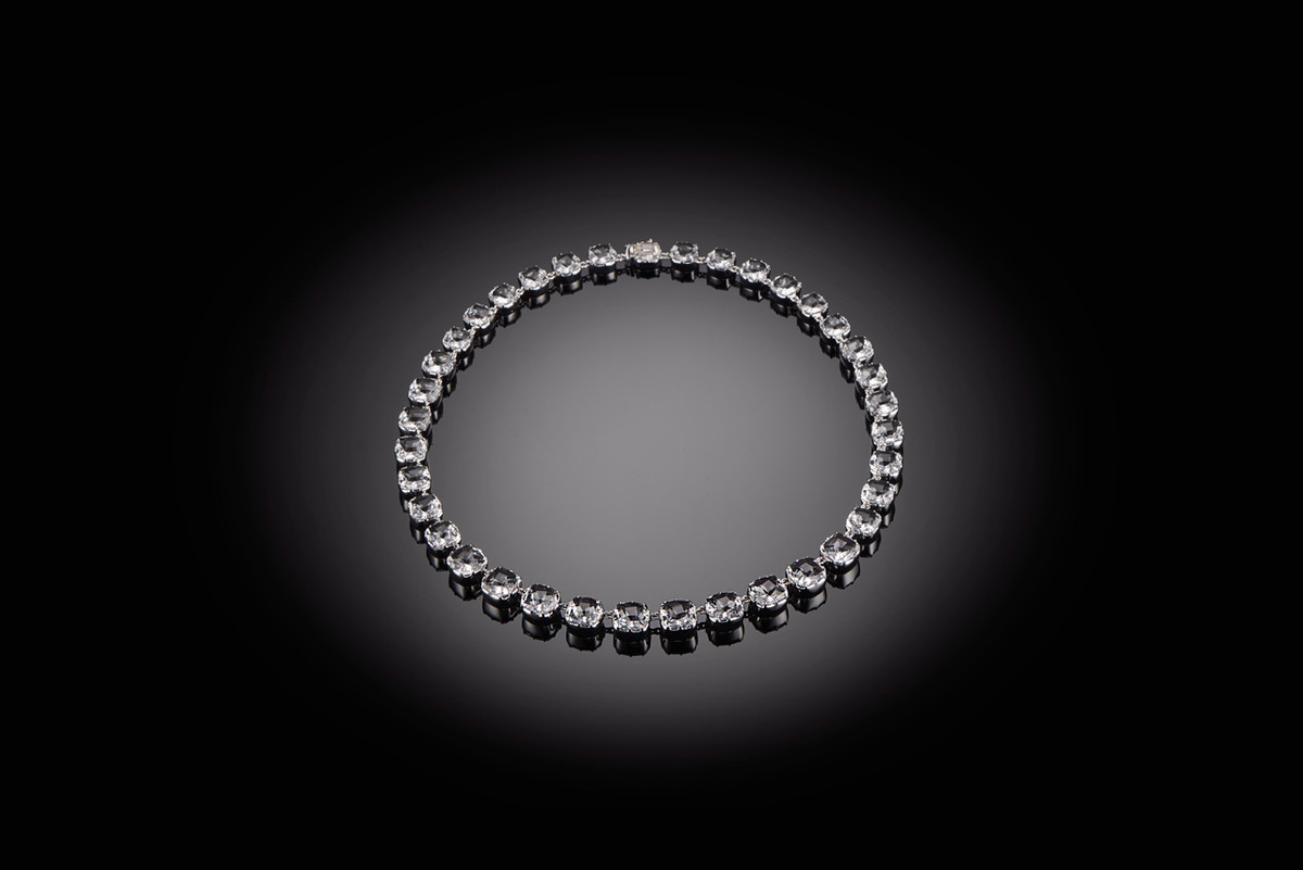 Kozminsky Large Rock Crystal Riviere Necklace. Comprising 34 graduating cushion cut rock crystal. Sterling silver and rhodium plated.  45cm