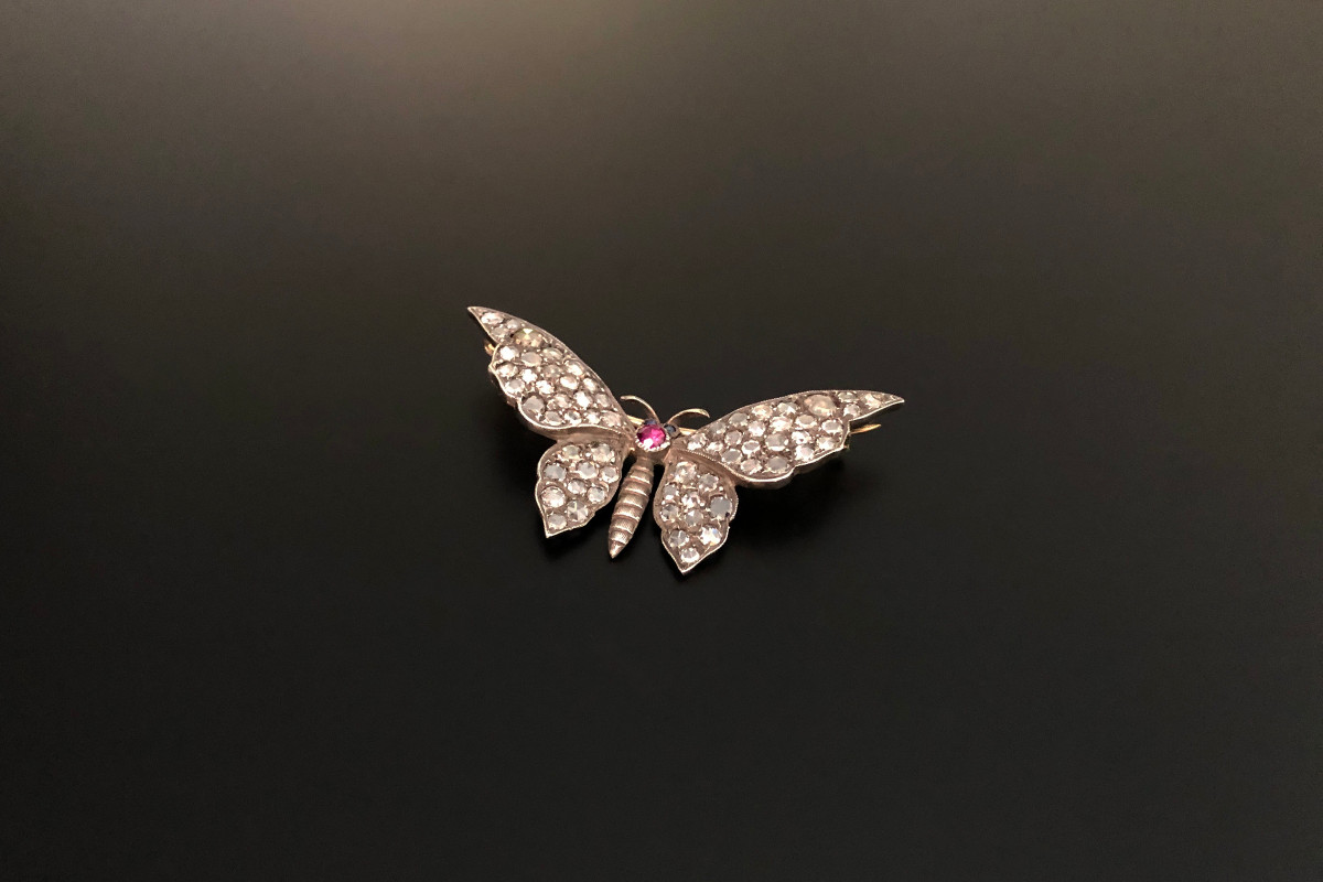 Rose cut diamond and ruby butterfly brooch.
