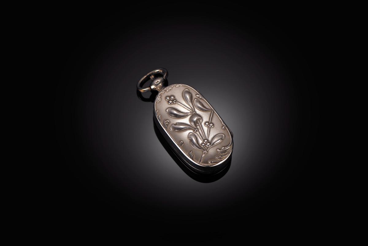 Art Nouveau Silver Sovereign case with mistletoe details.