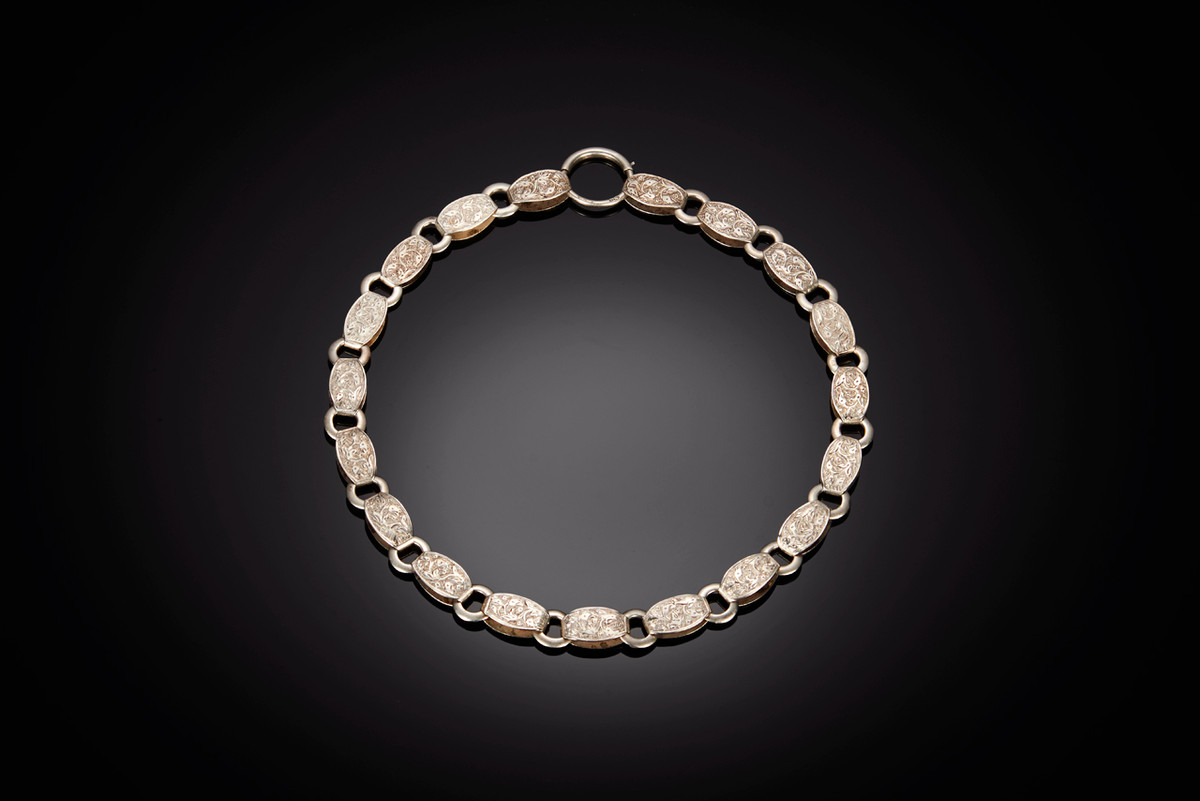 Victorian Silver Collar with engraved floral details.