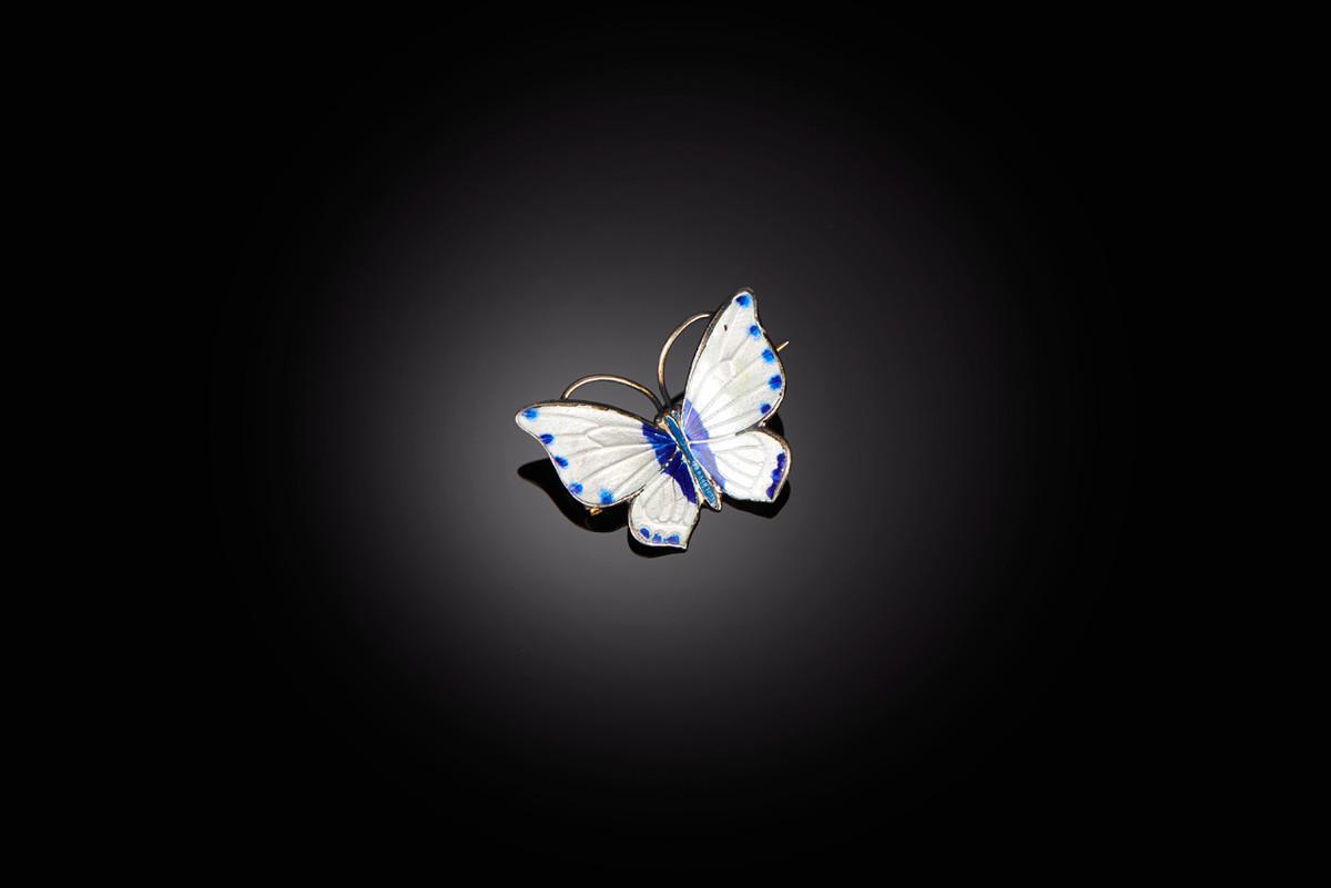 A Delightful White and Dark Bluel Enamel Butterfly Brooch