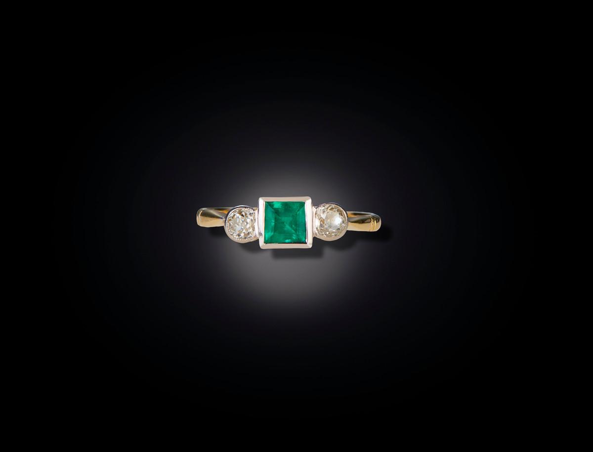 A Three Stone Emerald and Diamond Ring