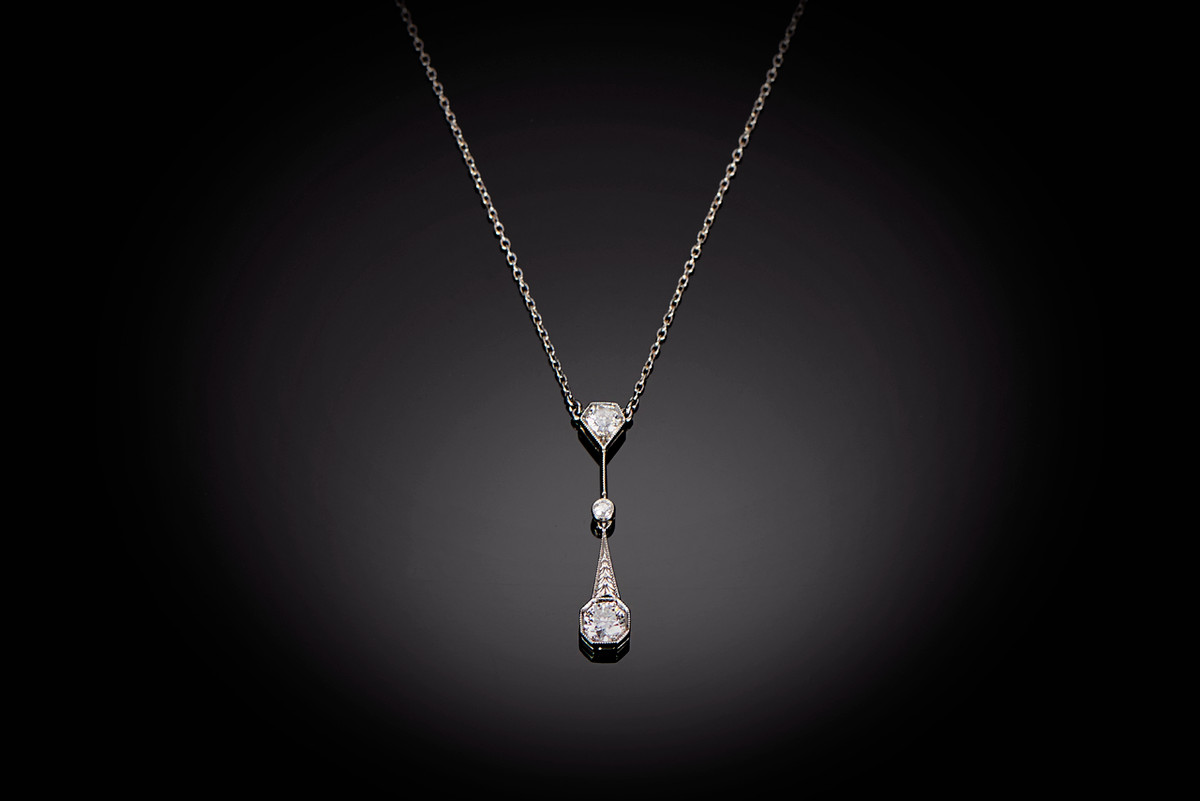 A Delicate Diamond Drop Pendant Necklace in Platinum