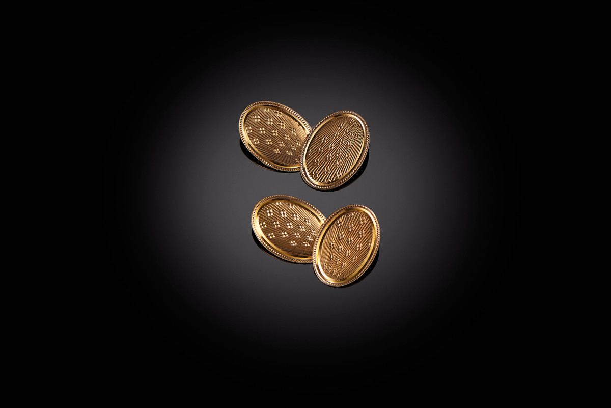 Gold Cufflinks with engine turned deatils.