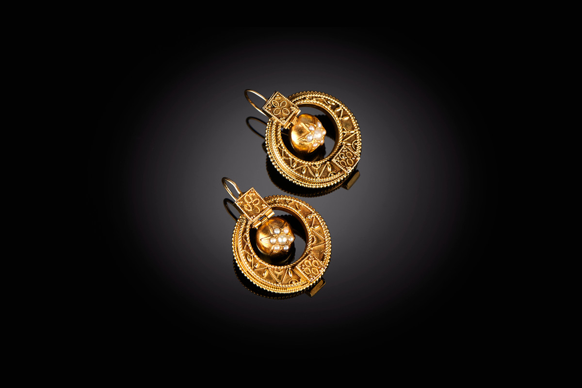 Victorian gold and pearl earrings.  Circular pierced form with applied cannetille decoration