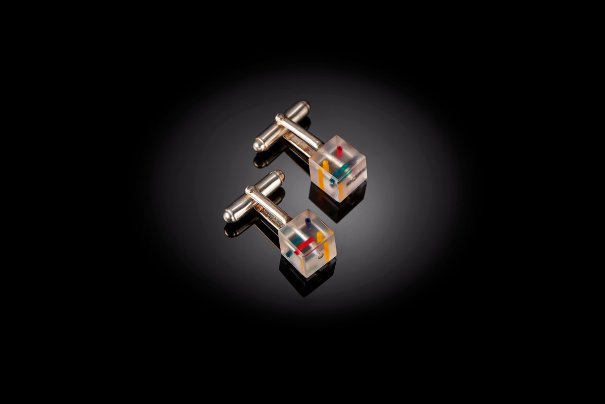 Perspex cufflinks with applied enamel paint. Sterling silver backs