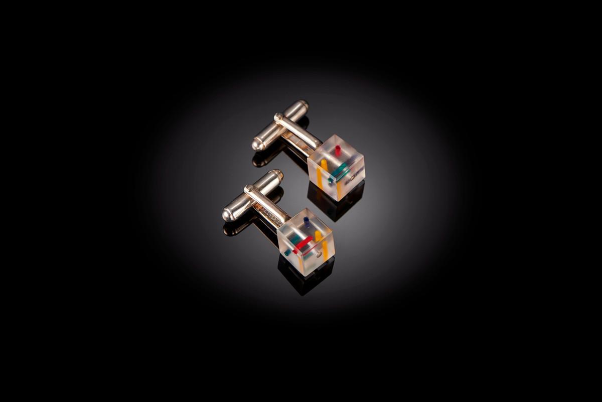 Perspex cufflinks with applied enamel paint. Sterling silver backs