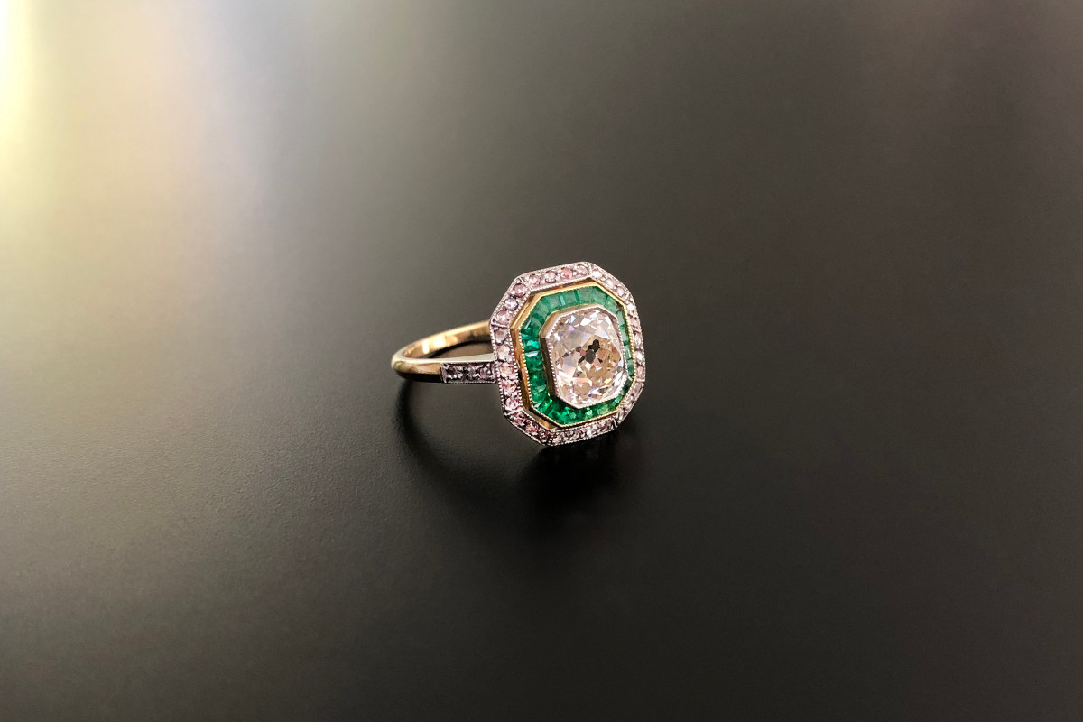 A Glorious Diamond and Emerald Cluster Ring