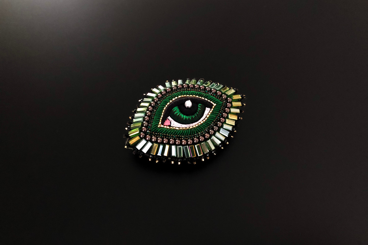 Green eye brooch with silk and beads by Celeste Mogador.