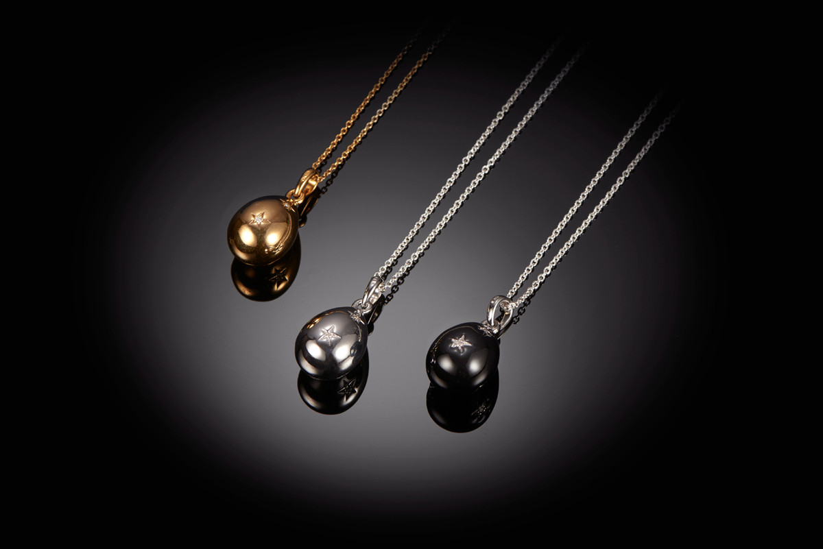 Kozminsky diamond egg pendant in silver, black enamel and silver gilt.