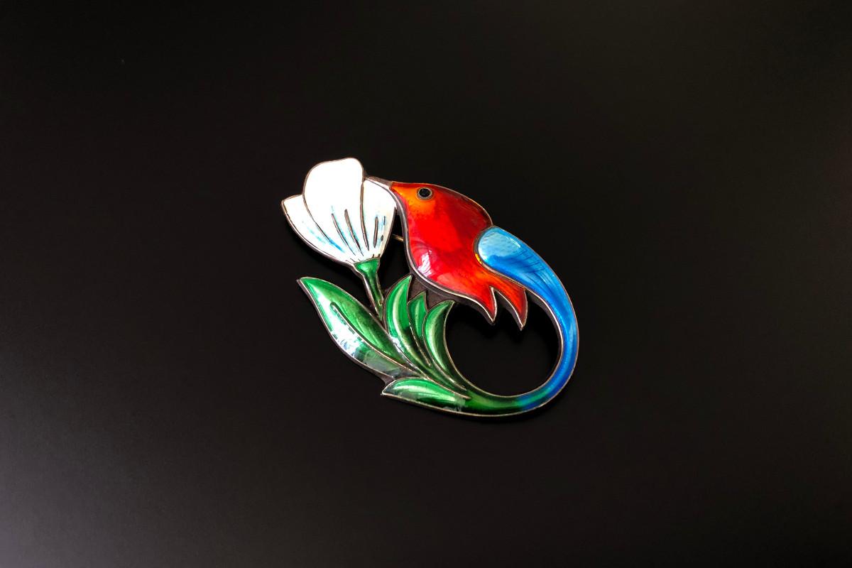 Hummingbird enamel brooch in silver by David Anderson.