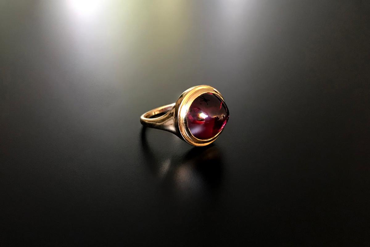 Kozminsky Garnet and Gold Ring.