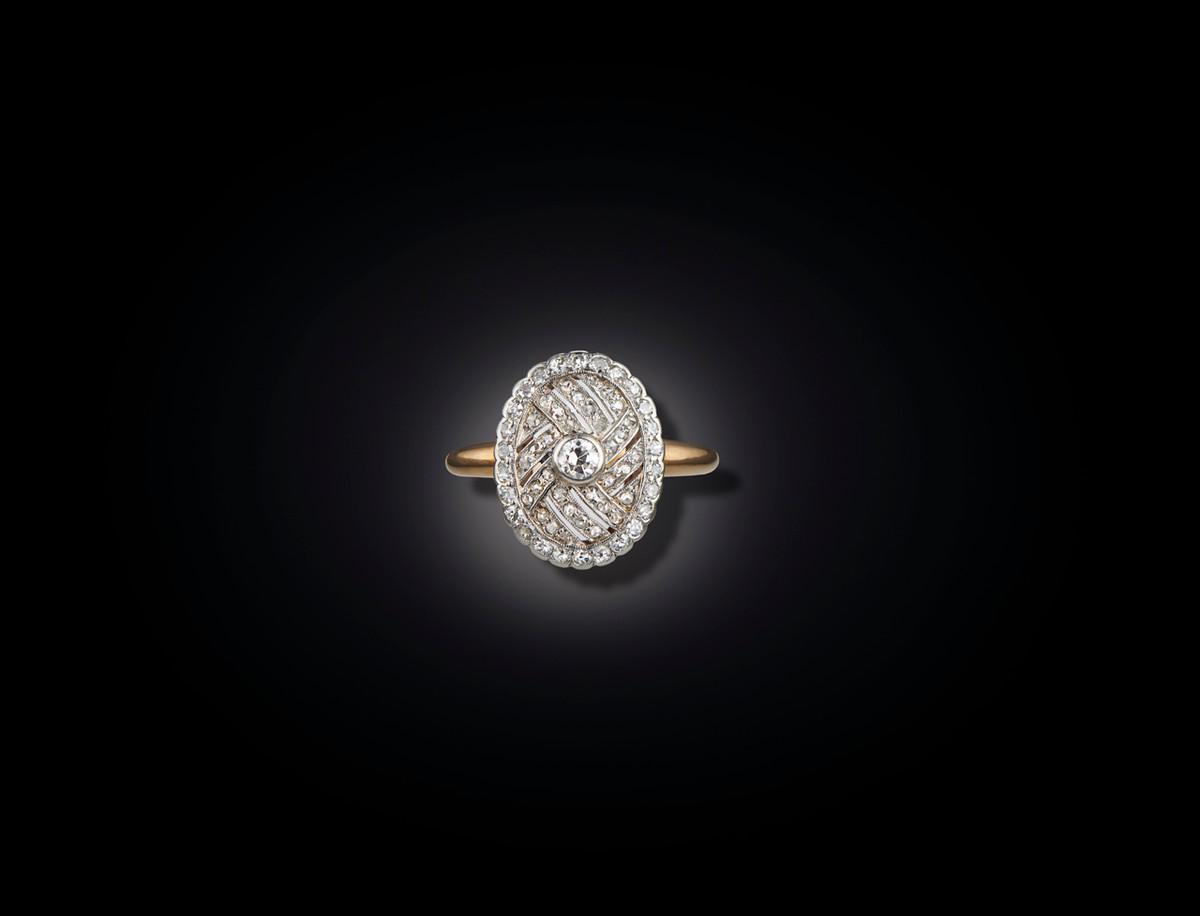Diamond Plaque Ring, oval pierced form, interwoven panels. Antique.