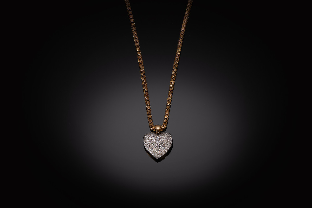 Diamond heart pendant, set throughout with old European cut diamonds.