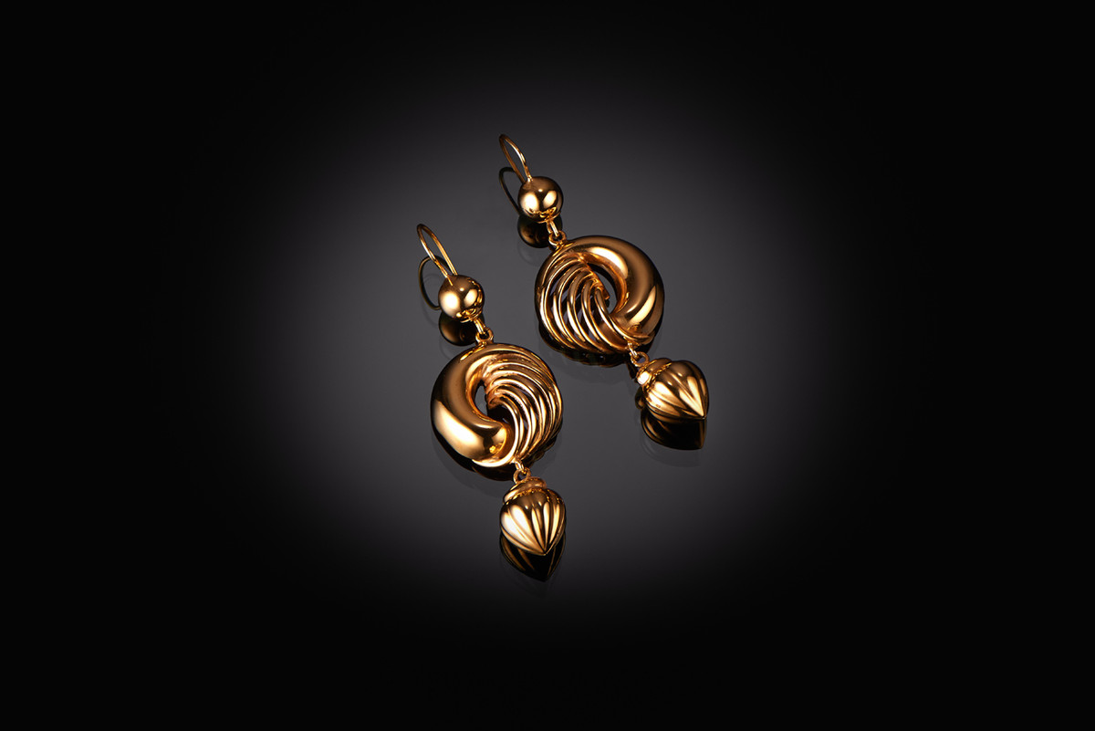 Pierced swirl design with fluted finial suspended below  surmounted by a sperical ball  9ct yellow gold  Antique