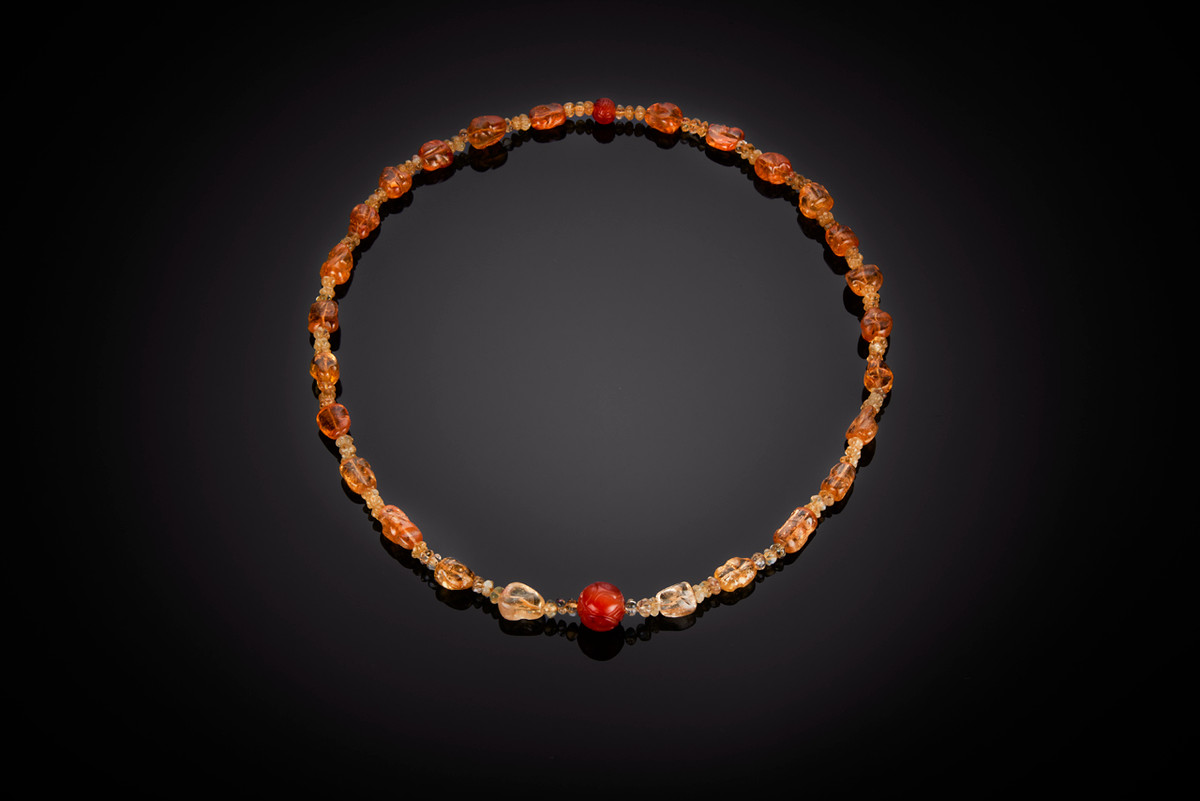 Imperial topaz beads necklace interspaced with small carved melon mandarin topaz beads. Highlighted by carved carnelian spherical beads Total length: 775mm