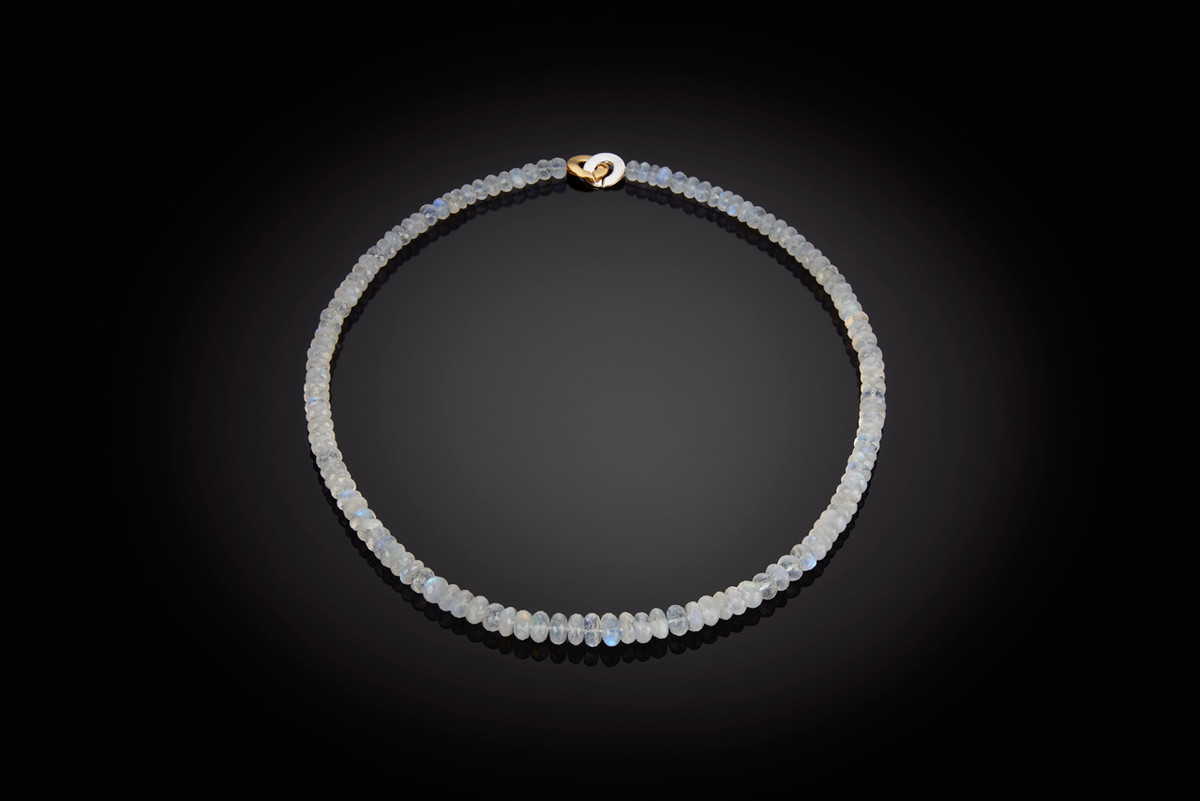 Hand faceted moonstone beads necklace  Individually knotted to a German silver and gilt clasp.  Total length: 690mm