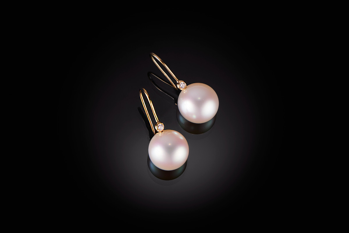 An exceptional pair of fine round South Sea Pearl earrings with bright white pink hues.