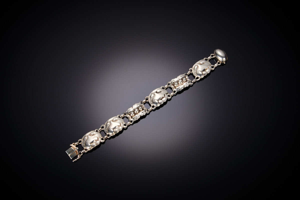 Sterling silver bracelet bt Georg Jenseb, comprising four bird panels interspaced with two vine leaf panels