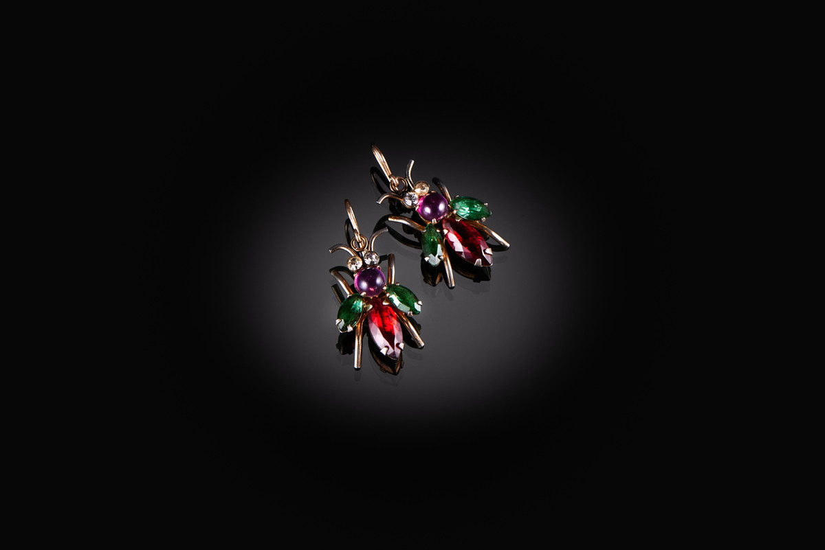Bug earrings with multi-colour paste.