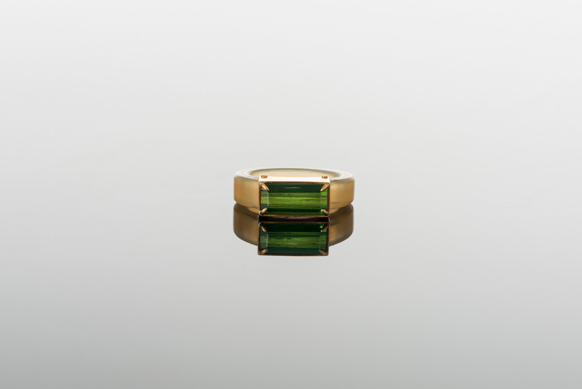 Rectangular cut Tourmaline and cow horn ring  Riveted setting.  22ct yellow gold.