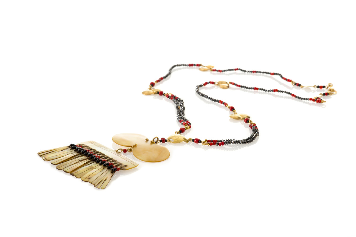 Fine and original Kalinga Mother of Pearl fringe shell  from the mountainous region of the Philippine Islands  presented on a fine black diamond strand  Hammered gold 22ct detailing.