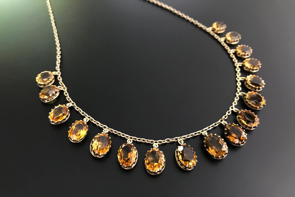 Citrine Necklace Eighteen oval cut citrines, claw set Silver gilt Total length: 420mm