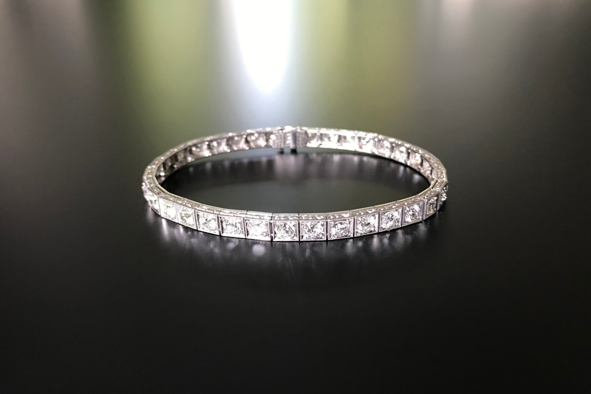 Diamond Line Bracelet Thirty five early round brilliant cut diamonds individually grain set in box link mounts  Platinum Total length: 180mm Total weight: 18.25gms Total diamond weight: 8.37cts Colour: I-J Clarity: SI-P