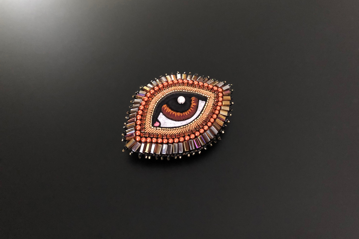 Chestnut Eye brooch by Celeste Mogadore.