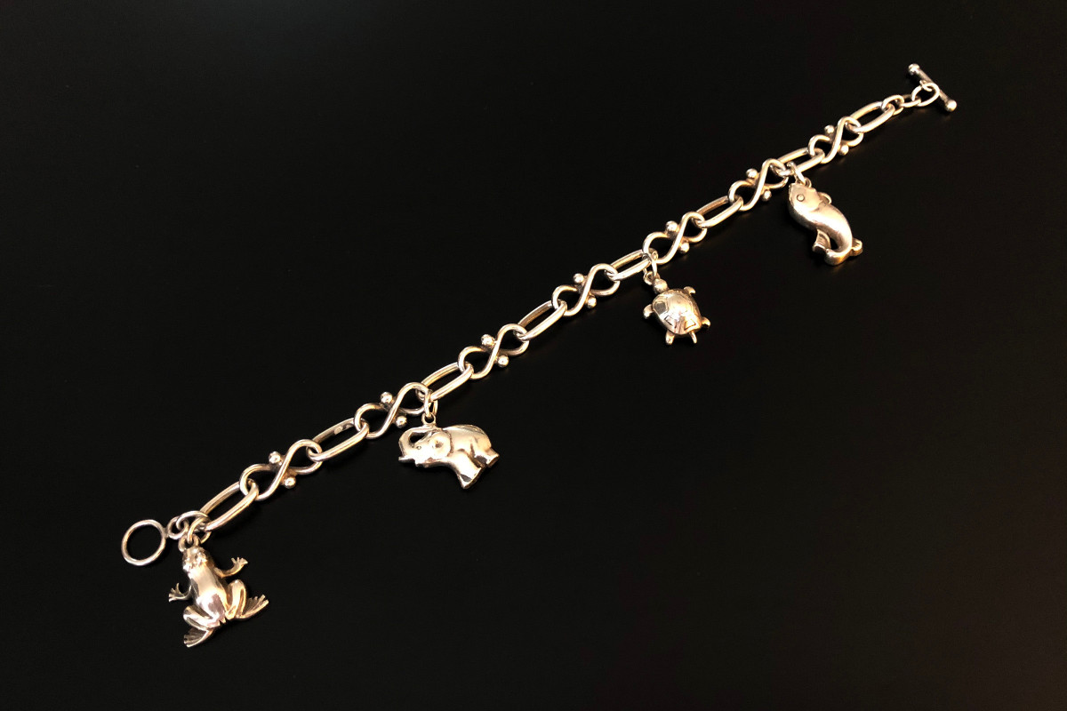 Georg Jensen Charm Bracelet The bracelet comprising of oval and figure eight linksFeaturing four sterling silver charms comprising:a turtle, a frog, an elephant and a fish.