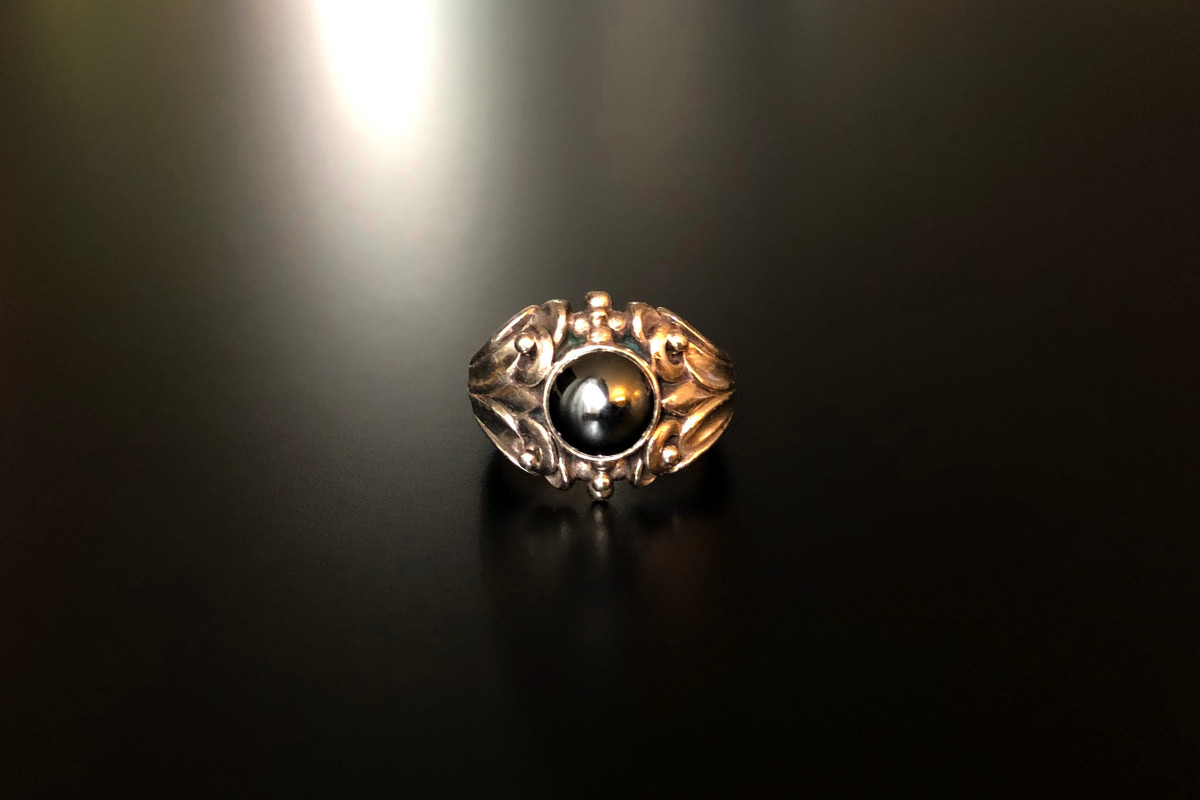 Georg Jensen Sterling Silver and Hematite Ring Round cut en cabochon Bezel set above a stylised foliate frame Sterling silver