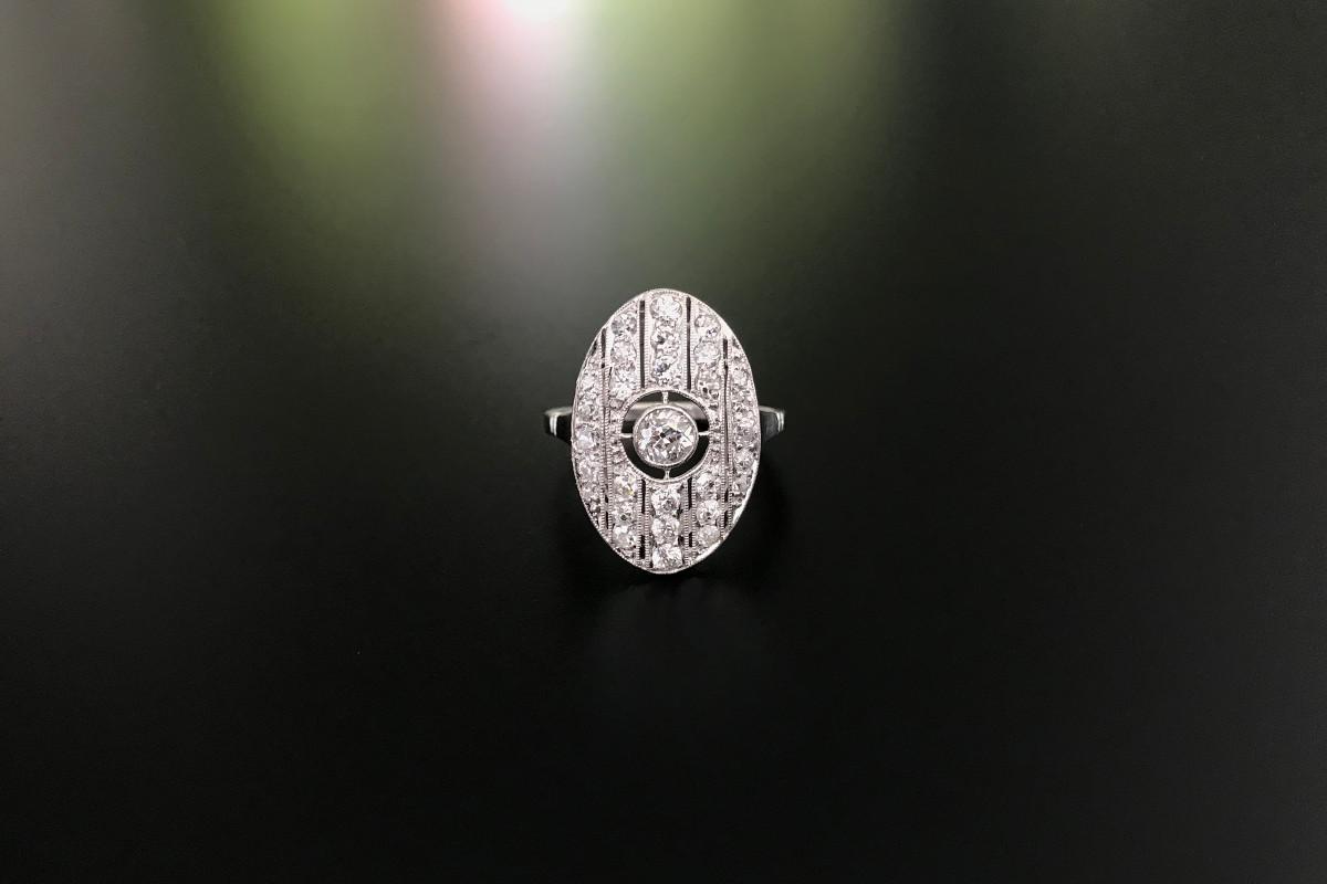 Oval Art Deco diamond plaque ring.