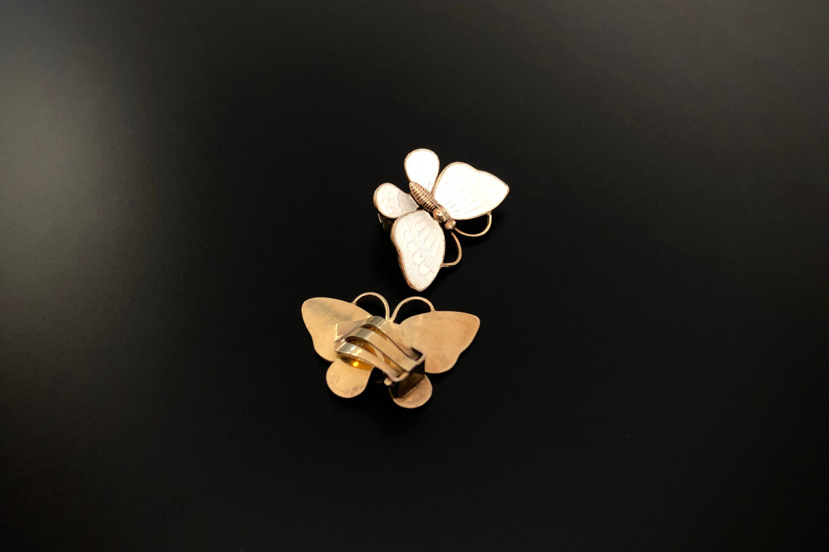 Enamel and Sterling Butterfly Brooch and Clip Earring Set By Volmar Bahnar White enamel with silver gilt body and antenna Stamped: VB Silver gilt Circa 1950s Denmark