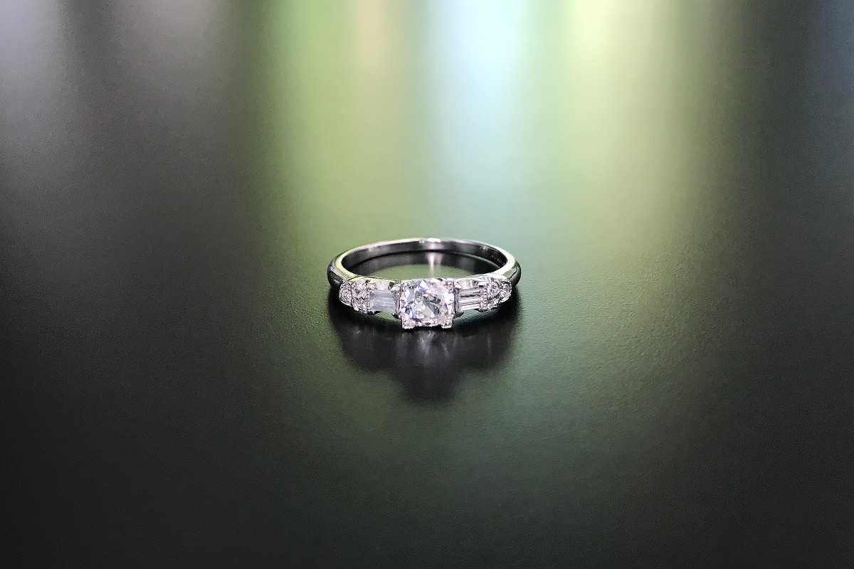 A Pretty Diamond Ring Centrally set with an old European cut diamond with baguette and round brilliant cut diamond detail Platinum Principal diamond: 0.36cts Total diamond weight: 0.86cts Colour: G-H Clarity: SI Total weight: 3.38gms