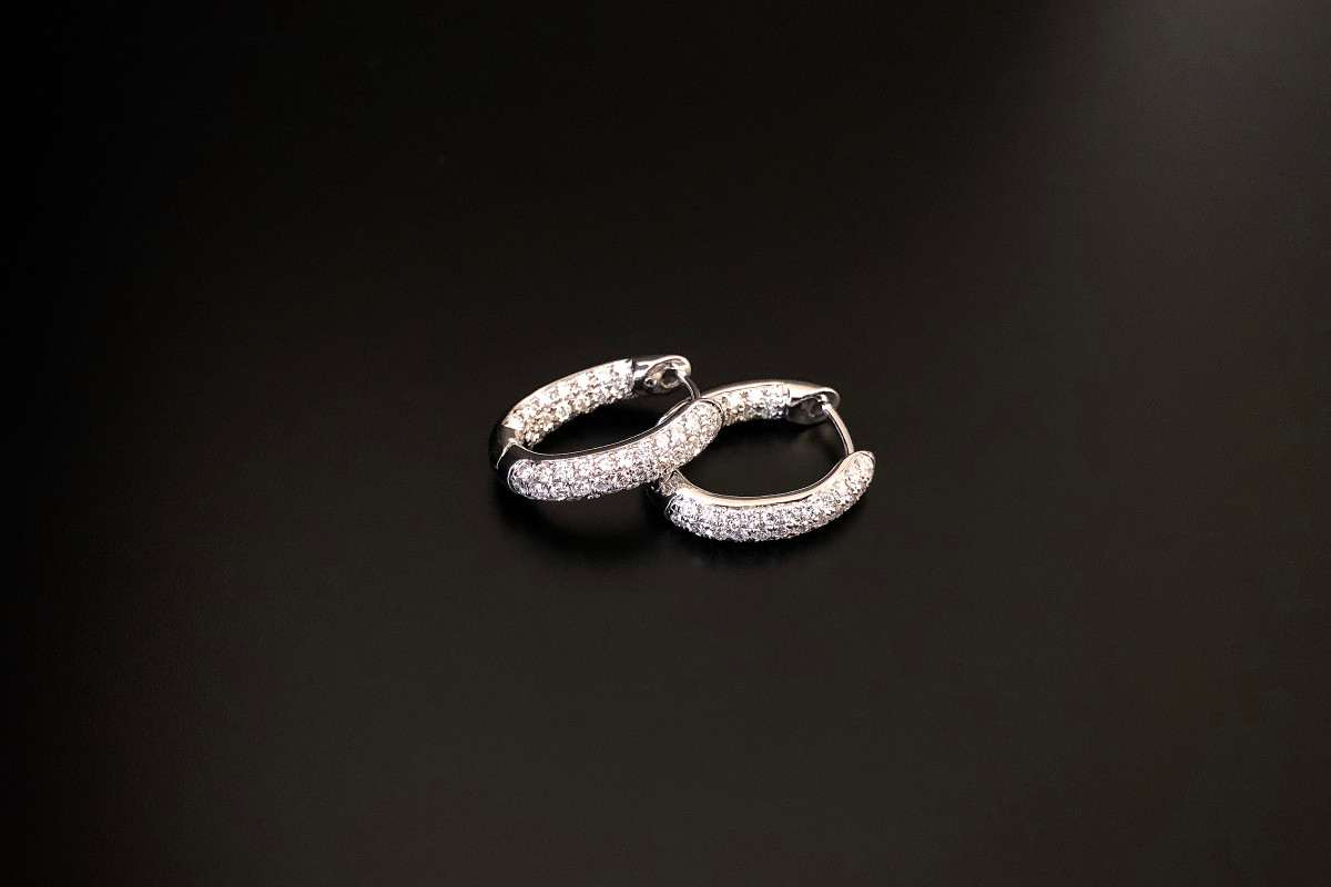 A Stylish Pair of Diamond Huggie Earrings Pave set with round brilliant cut diamonds Total diamond weight: 0.94cts Colour: G Clarity: SI 18ct white gold Total weight: 3.85gms