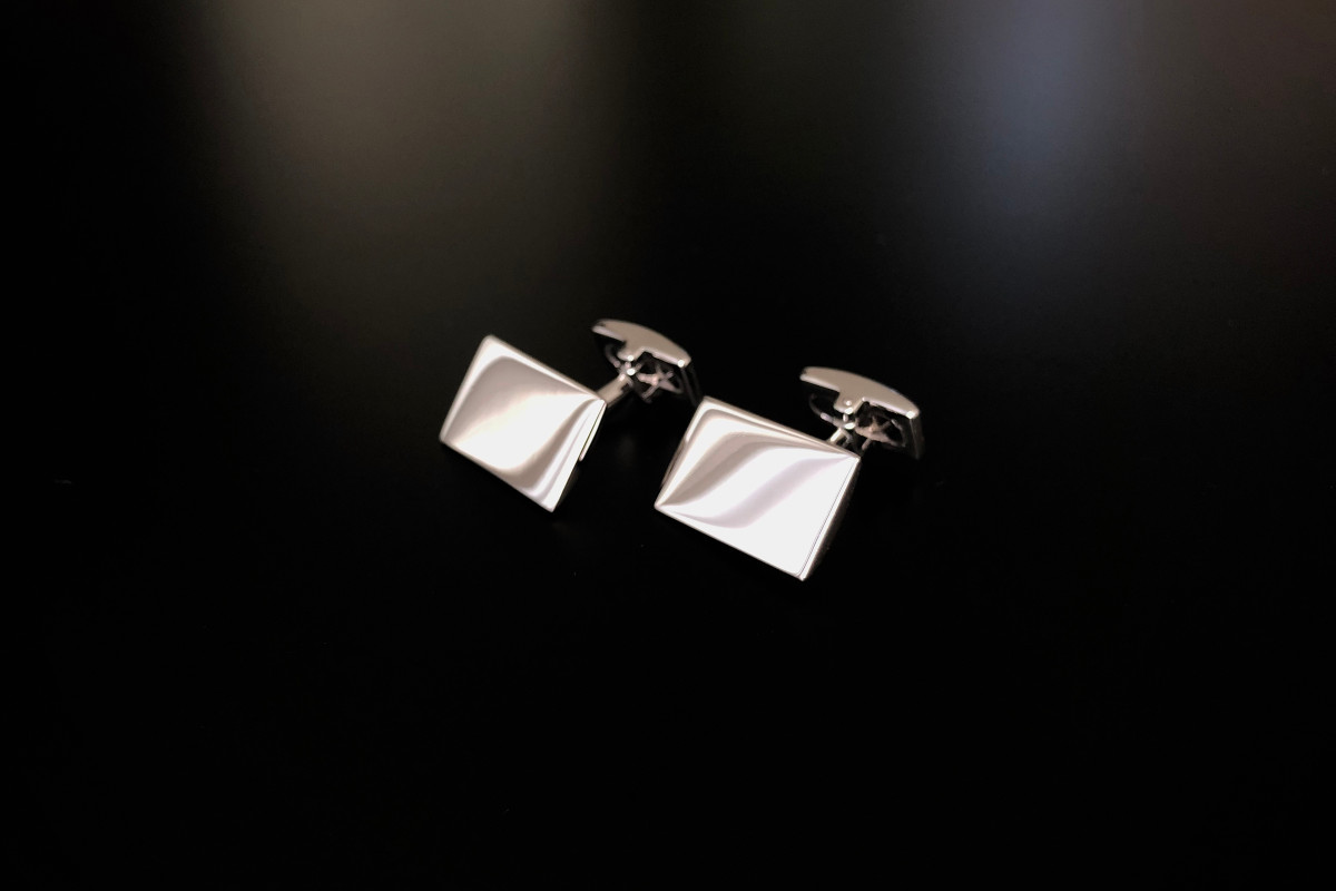 Rectangular cufflinks with convex rectangular panel to the opposing end. Sterling Silver.