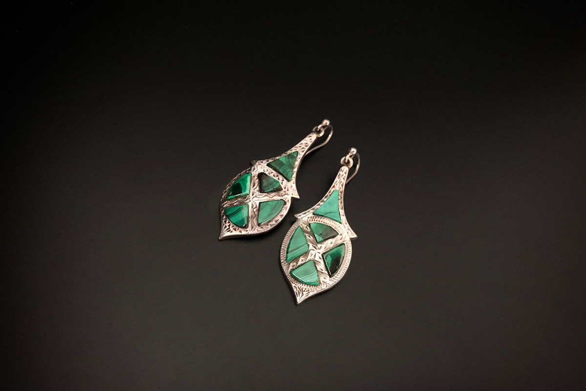 A Smart Pair of Silver and Malachite Earrings Pendeloque drop design Featuring five triangular panels of malachite Engraved decoration Hook fittings Silver Victorian