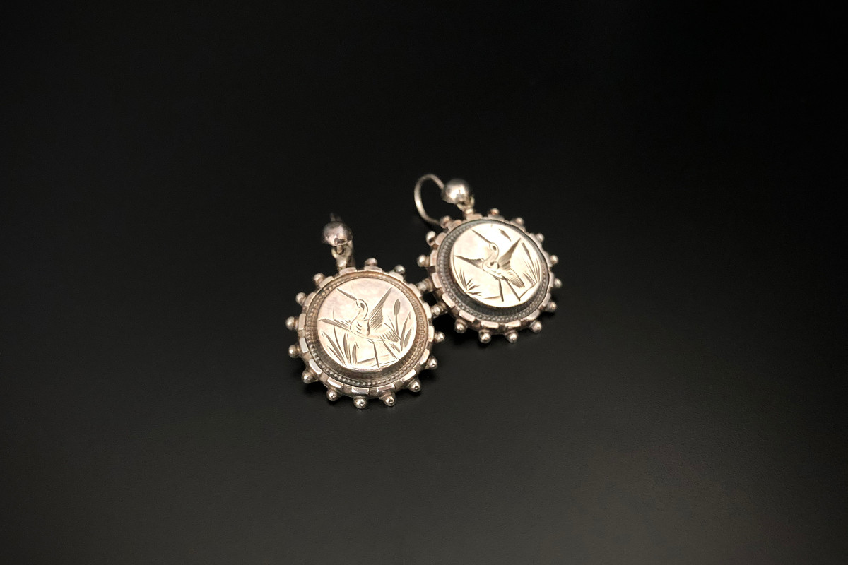 Silver disc earrings with engraved decoration of stork. Beaded border. Victorian.