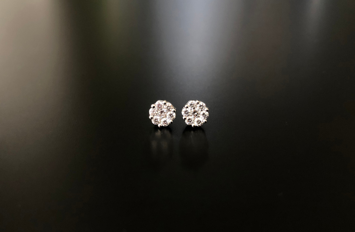 Classic Diamond cluster studs, containing fourteen brilliant cut diamonds. Total diamond weight: 0.55cts 18 carat white gold setting.