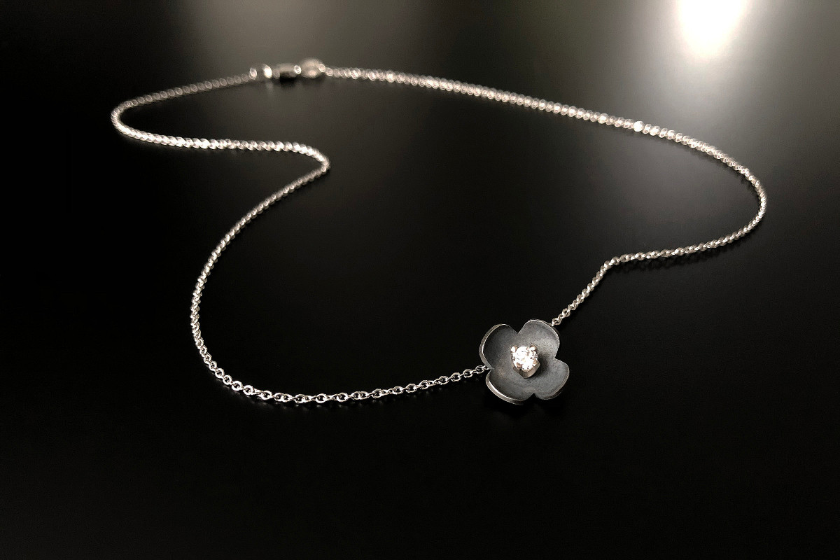 Sakura pendant with diamond. 18k white gold and oxidized silver.